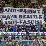 PORTLAND, OR - AUGUST 23: Seattle Sounders supporters group ECS (Emerald City Supporters) remained silent for the first 33 minutes of the game to denounce MLS stand on the iron front symbol during the Seattle Sounders 2-1 victory over the Portland Timbers at Providence Park on August 23, 2019 in Portland, OR (Photo by Diego Diaz/Icon Sportswire).